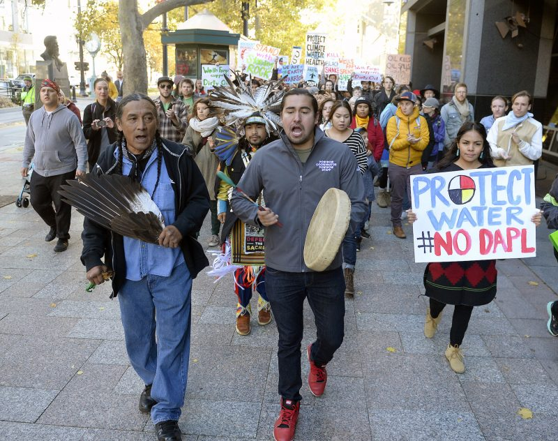 Protesters march in protest against the Dakota Access pipeline.