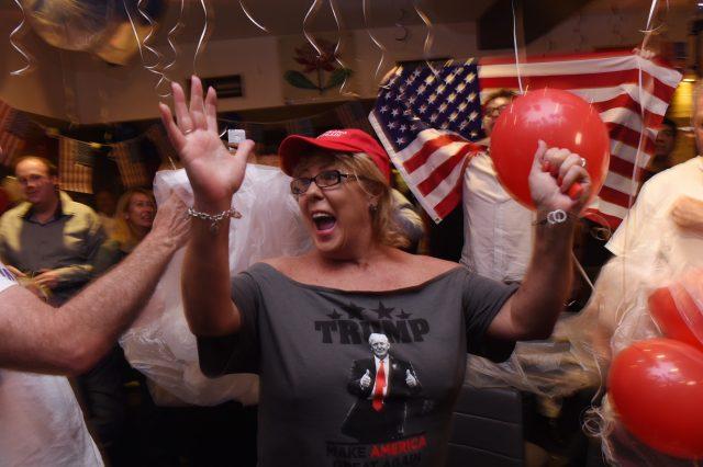 A Trump supporter celebrates his victory.
