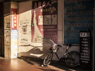A bike in a Chinese part of Prato, Italy.
