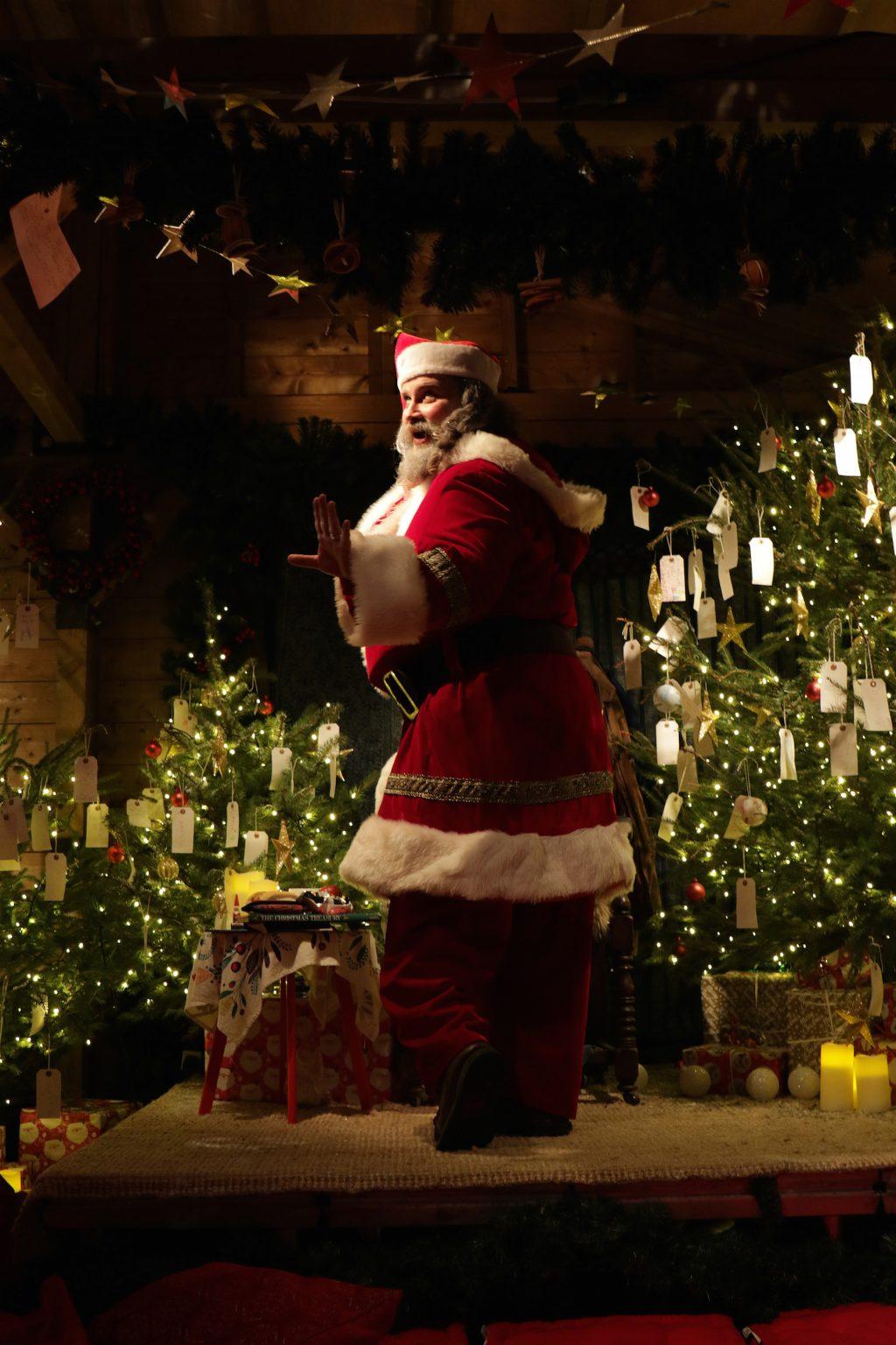 Santa Claus dancing.