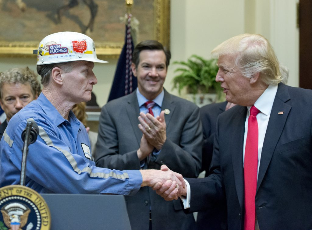 Trump shakes hands with coal miner in the White House. Feb 2017.