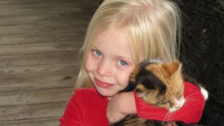 Blond Kitten Girl Smiling Young Hugging Child