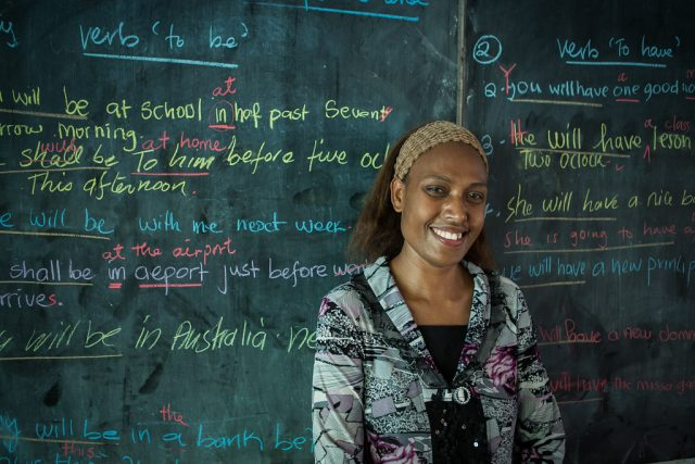 Grade 11 teacher Annette teaches English to her students  at Nor