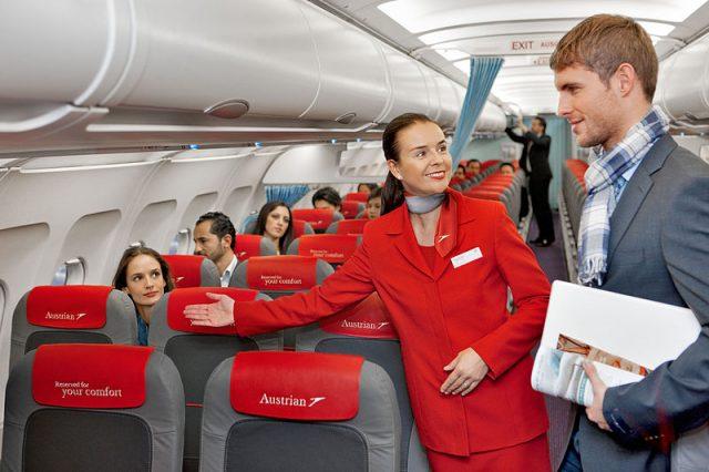 Austrian_Airlines_flight_attendant_and_passenger