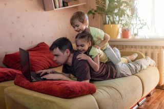 happy-man-with-children-using-laptop-and-earphone-during-his-home-working-life-in-quarantine-mobile_t20_pLykZd