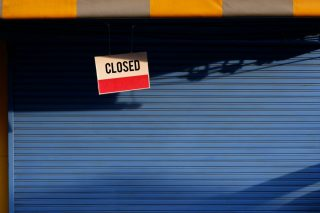 closed-shop-label-notice-sun-blind-grocery-store-shutter-door-sunlight-and-shadow-closed-sign-board_t20_0x7Jw2