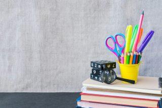 school-supplies-mockup-on-blackboard-background-with-copyspace-school-back-mockup-supply-black-bright_t20_XzJdAz
