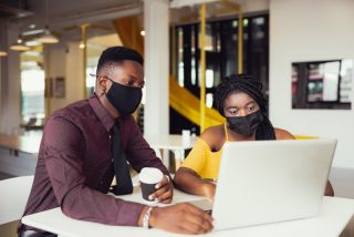 african-students-with-friends-wearing-mask-sitting-at-desk-at-modern-school-virus-protection-at_t20_ml6Bvd