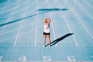 blue-running-stretching-sports-run-woman-athlete-athletics-fitness-running-track_t20_px8Z4P