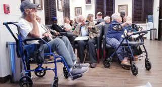 healthcare-and-medicine-a-doctors-waiting-room-filled-with-patients-many-in-severe-pain-in-walkers_t20_YwPzxj